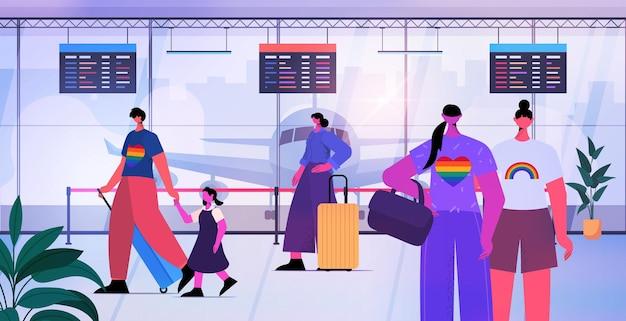 Lgbtのレインボートランスジェンダーの愛の概念をチェックするために空港のカウンターに並んで立っている乗客