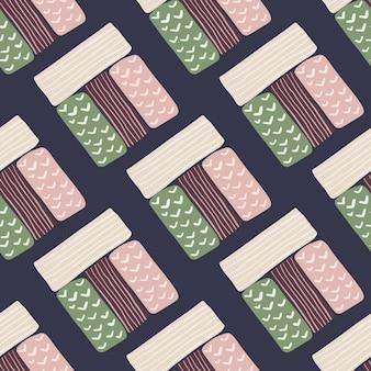 パステルカラーの長方形のシルエットのシームレスパターン。ネイビーブルーの背景。白、ピンク、緑、暗い栗色の幾何学図形。