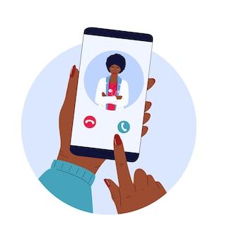 患者はオンラインで医師にビデオ通話をします。遠隔医療。アフリカ系アメリカ人の医療従事者