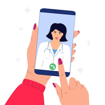The patient makes a video call to the doctor online. hands holding smartphone. telemedicine concept.