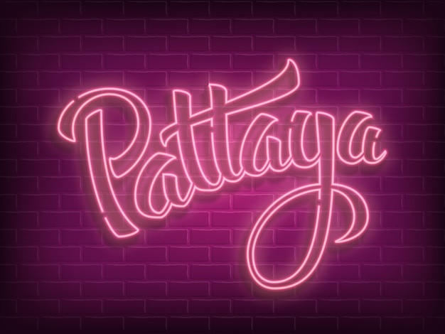 Pattaya lettering neon sign on brick wall