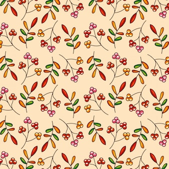 Pattern autumn leaves and red fruits