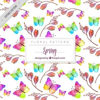 Pattern di farfalle colorate con fiori di acquerello
