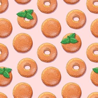 Pattern of donuts decorated with powdered sugar and mint.