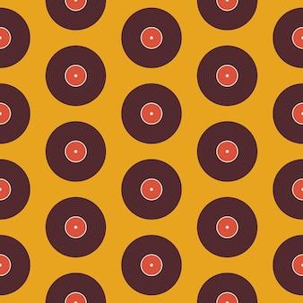 Образец музыкального винилового диска над желтым. предпосылка текстуры вектора плоского стиля безшовная. музыкальный шаблон. ретро винтаж виниловая пластинка