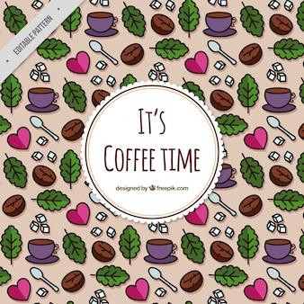 나뭇잎과 하트 커피 컵의 패턴