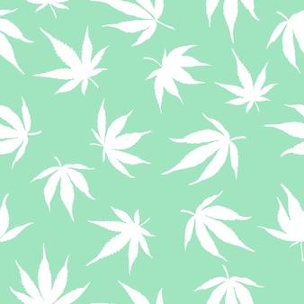 緑の背景に白い大麻のパターン。ベクトルイラスト