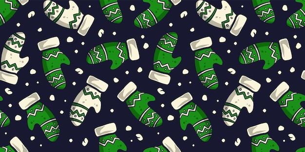 クリスマスまたは冬のミトンのパターン壁紙