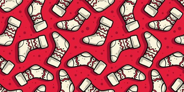 クリスマスまたは冬の靴下とパターンの壁紙