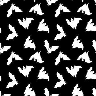 黒の背景に白いコウモリのパターン