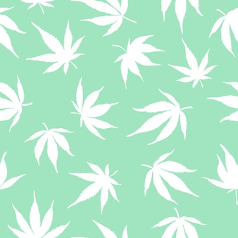 Pattern of white cannabis on a green background. vector illustration