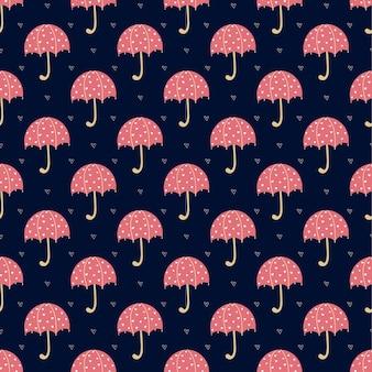 青い表面に真っ赤な傘とハートのパターン。傘とかわいい秋のパターン