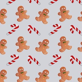 灰色の背景にクリスマスキャンディーとジンジャーブレッドマンのパターン。ベクトルイラスト