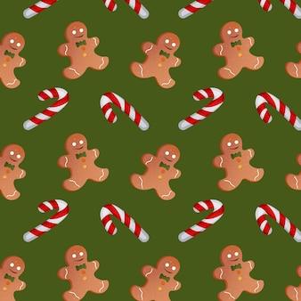 緑の背景にクリスマスキャンディーとジンジャーブレッドマンのパターン。ベクトルイラスト