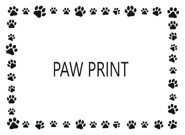 足跡。白い背景の上のフレーム。犬または猫。