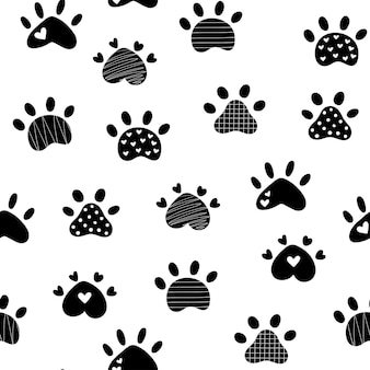 Paw print repeating seamless pattern silhouette dog paw doodle style vector illustration