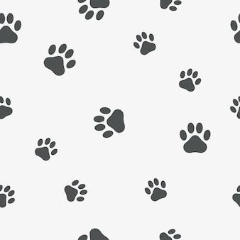 足のシームレスパターン。動物の足跡の背景-猫、犬、クマ。ベクトルイラスト。