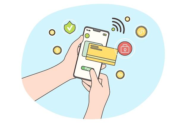 銀行のアプリケーションでワイヤレスで電子財布を介してクレジットカードで取引を支払う。携帯電話を持っている人間の手。