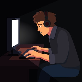 デスクトップpcのコンピュータ画面に座っている男