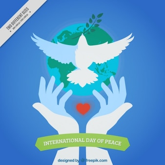 Peace day background of hands releasing a dove