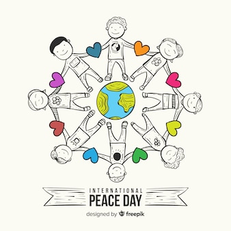 Peace day composition with children holding hands around the world