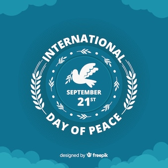 Peace day composition with flat white dove