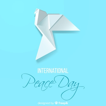 Peace day concept with origami dove
