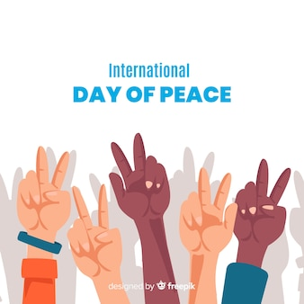 Peace day concept with raised hands