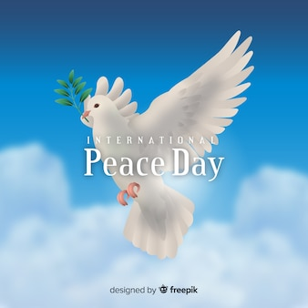 Peace day concept with realistic dove