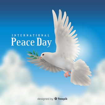 Peace day concept with realistic dove Premium Vector