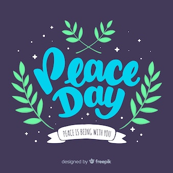 Peace day lettering background with plants