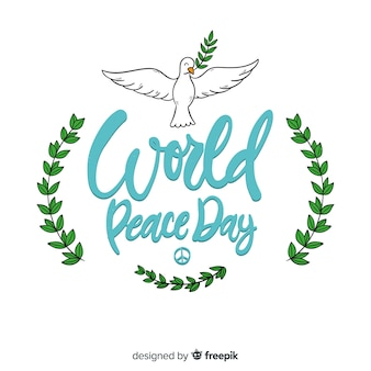 Peace day lettering with dove