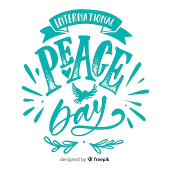 Peace day lettering with doves