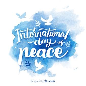 Мирный день акварельной надписи фона