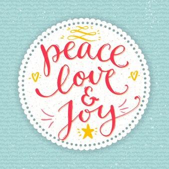 평화, 사랑과 기쁨 텍스트입니다. 사용자 정의 필기 유형, 벡터 포인트 펜 서예가 있는 크리스마스 카드. 블루 니트 질감 배경에 라운드 프레임에 빨간색 문구.