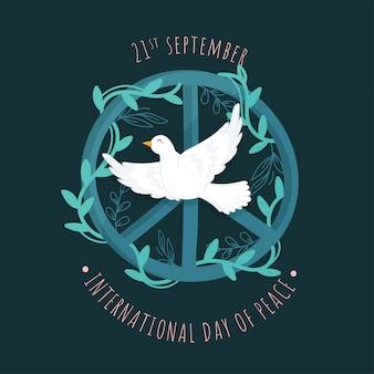 Символ мира, украшенный листьями и летающим голубем на зеленом фоне.