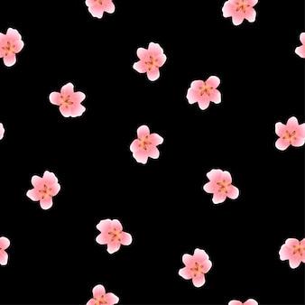 黒の背景にシームレスな桃の花