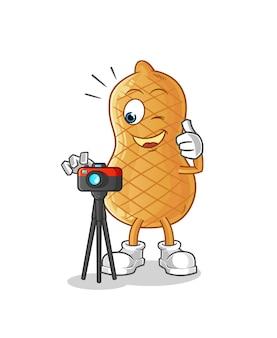 Peanut cartoon character photographer