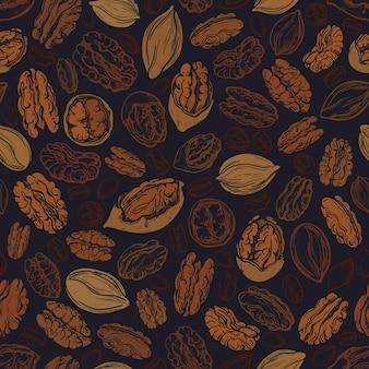 피칸 브라운 너트 완벽 한 패턴입니다. 마른 씨앗의 질감 그림입니다. 건강한 음식