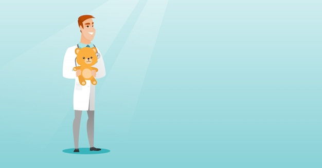 소아과 의사 테 디 베어를 들고입니다.