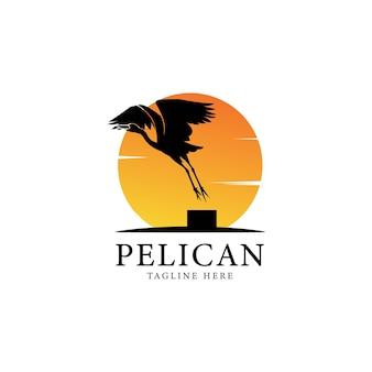 太陽とペリカンの鳥のロゴのヴィンテージ