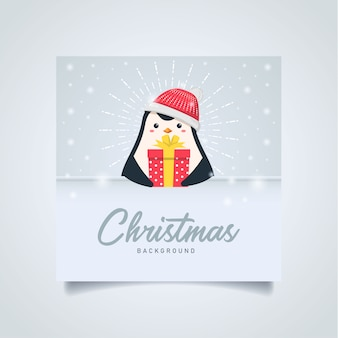 Penguin cartoon holding gift box christmas greeting card with copyspace