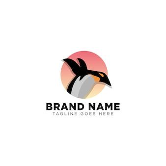 Penguin in sunset logo template