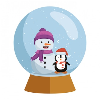 Penguin with santa claus hat in snow sphere