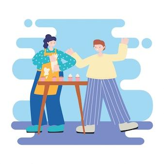 人の活動、甘いカップケーキ漫画を調理するカップル