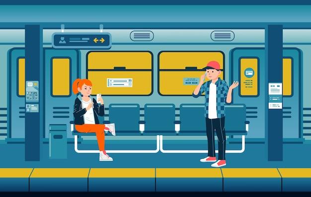 사람들은 전화로 바쁘게 지하철 플랫폼에서 기차를 기다리고 있습니다.