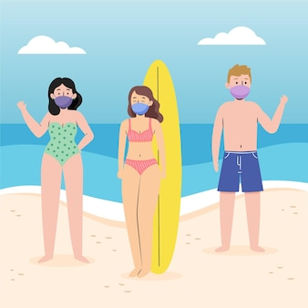 People at beach wearing face masks