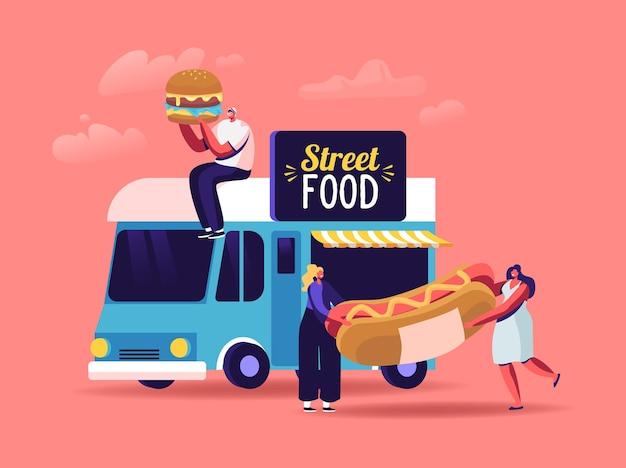 사람들은 바퀴 달린 카페 또는 푸드 트럭에서 길거리 음식, 테이크 아웃 정크 식사를 구입합니다.