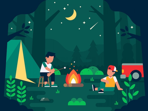 People camping at night in the forest