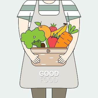 新鮮な有機果物と健康的な自然野菜がいっぱい入ったバスケットを運ぶ人々。